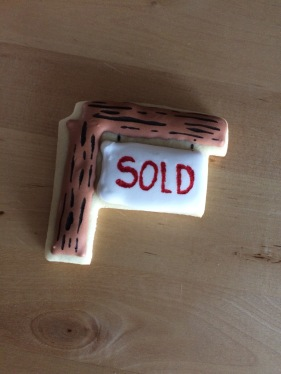 'SOLD' cookies I made for our realtor when we bought our new home! I didn't get the mini houses I made him though..