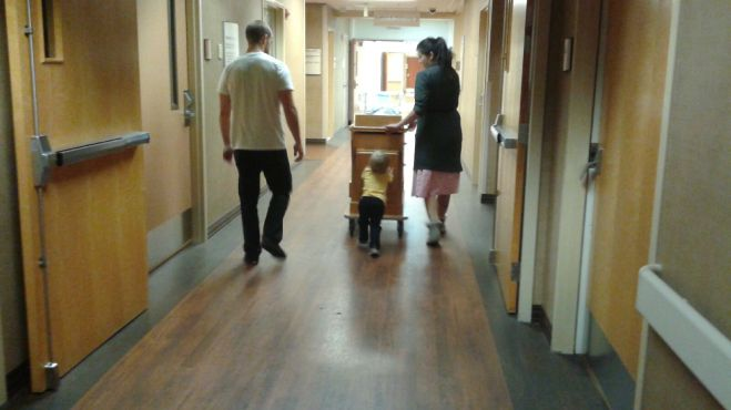 Family walks around the hospital
